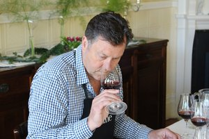 Cuisine magazine wine writer John Saker evaluates pinot noir at the French residence. - JPEG
